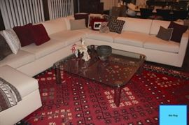 Sectional with Accent Pillows and Mid-Century Coffee Table
