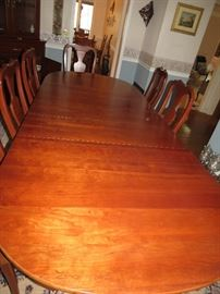 COMMANDING BEAUTIFUL MAHOGANY DINING ROOM TABLE AND 8 CHAIRS AVAILABLE FOR EARLY SALE  $900.
