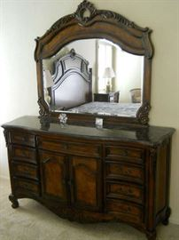 Ladies dresser with marble top and beveled mirror