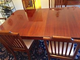Antique dining room table -  with leaves and pads