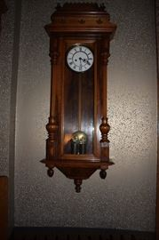One of several antique wall clocks