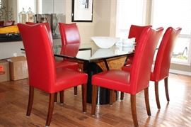 Contemporary dining table with 6 leather chairs