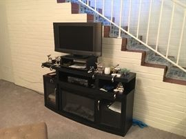 Flat  screen TV DVD player TV cabinet has a electric fireplace