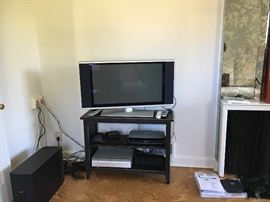 Plasma Flat screen TV  nice black TV stand