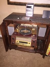Victrola vintage radio/ turntable, closed up to just a cabinet