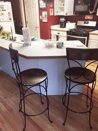 Two vintage kitchen stools