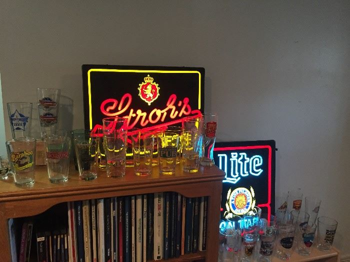 Some of the beer signs and a TINY portion of the loads of beer glasses we are selling!