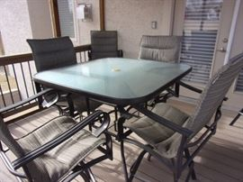 Pub height patio table and 6 chairs