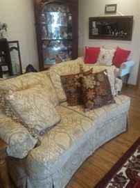 tone on tone Thomasville love seat, white bench, pillows, curio