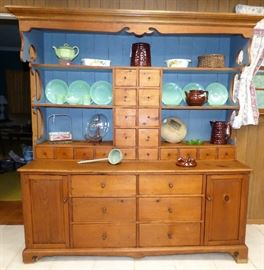 """Antique pine """"cupboard of many drawers""""."""