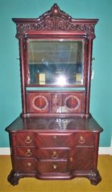 Gorgeous, highly unique antique mahogany piece.  There has been some repair work on this.  See next few pictures.....