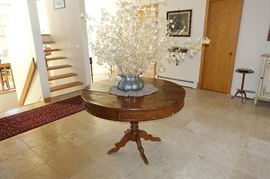 Antique round entrance hall table with antique pewter vase
