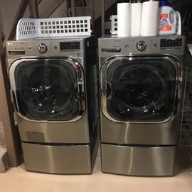 LG True Steam Washer and Dryer all electric on stands