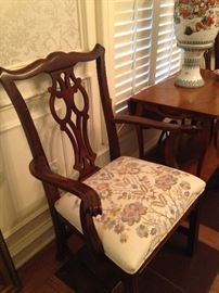 One of the two host dining chairs