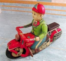 Cardinal toy motorcycle c op with internal wind up spring mechanism that keep it moving and still functioning