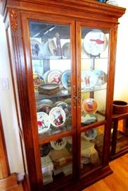 Display cabinet with collection of bird plates