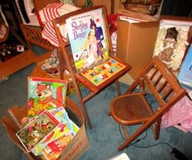 Child's vintage folding desk and chair with many early Disney coloring books, puzzles and story books