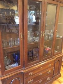 "China cabinet. Measures about:  57"" wide, 13"" deep, 7' high"