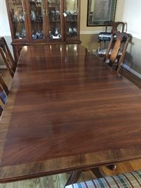 "Dining table with two leaves - 8 chairs. Table measures about 42"" wide, 102"" long, 29"" high"