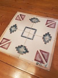 Signed tile in center of table