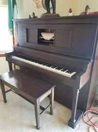 "Cunningham player piano. 64"" wide x 54"" tall x 28"" deep"