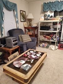 Recliner, End tables, glass top display coffee table, Ceramic masks, afghans/blankets, stereo components, lamps, art, decor