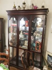 Scalloped widow in this glass and wood display curio, display, catinet