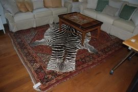 Pair of Crate & Barrel Sofas, Antique handmade rug, great coffee table and a Zebra rug