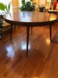 Mid-Century 48 inch round dining table with leaf/expander.