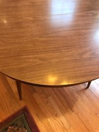 "Top laminate surface of 48"" round Mid-Century table."