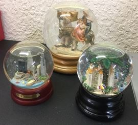 Snow globes: Chicago skyline, another of Naples, oversize globe of Holy Family