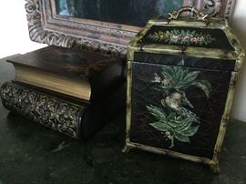 "Wooden boxes: painted lidded wooden box with black crackle finish, bird & floral design, faux bamboo corners & feet, snake/dragon metal handle on lid, 2 connected ""book style"" wooden boxes painted with decorative angel motif on top & golden accents on lower box, top-opening lid on upper box & drawer for lower box"