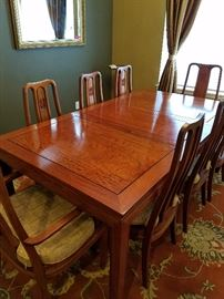 "Beautiful hardwood (rosewood) dining table with 8 chairs and two leaves.  Far Eastern Furnishings Co. Hong Kong.  Series R.  Table w/o leaves 58"".  Each leaf is 18"".  42"" wide and 30"" high."