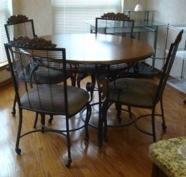 Wood & iron dining table with four chairs