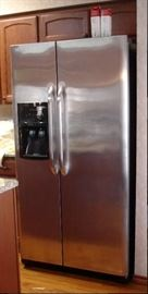 Frigidaire side-by-side stainless refrigerator in excellent condition. Approximately 5-6 years old.