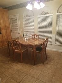 Solid Fruitwood Dining Set - includes three leaves.  Shown with one leaf.  Custom Glass top and pad