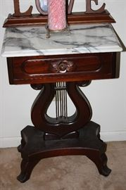 There is a pair of beautiful Marble Top  Lyre Tables