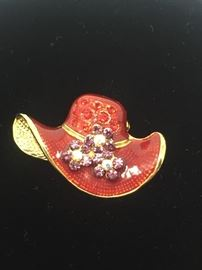 Small red hat pin with rhinestones.
