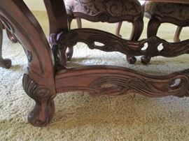 Heavy carving details on trestle base of table