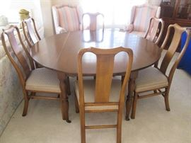 "Unique Dining Room Table:  Subtle and classic Colonial style with 2 drop-leaf sides.  Also has 2 extra 22"" leaves and pads.  Support system with gears accommodates extra leaves.  Sizes:  60"" open/30"" sides down/104"" X 60"" fully open with both leaves.    6-Chairs sold separately.  All in very good condition!"