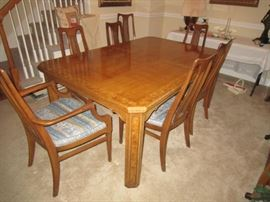 Dining room table has 2 leaves & pads. Chairs sold separately