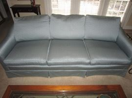 One of a pair of blue sofas