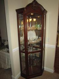 Corner cabinet, glass shelves, light