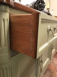 Close up of drawer on buffet.