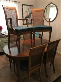 Vintage dining room table, includes 3 leaves, 2 captains chairs with arms and 4 chairs.  This set also includes painted buffet and mirror.