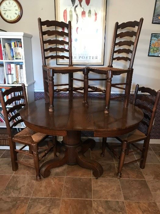Very heavy antique oak table, includes 3 leaves (one leaf is shown) and 4 chairs.  Table is on wheels for easy moving.