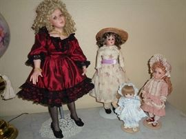 several hand painted dolls