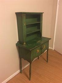 Green antique kitchen storage unit.