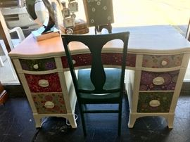 AWESOME antique curved front desk that has been chalk-painted and customized (by Sharon Gretza) with bright fabric-front drawers.