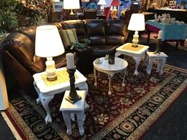 2-Piece Brown Leather curved sofa w/ center piece, beautiful lamps, and custom painted end tables.